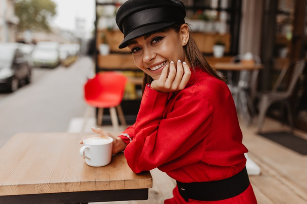 lady-casual-outfit-posing-with-smile-street-portrait-happy-smiling-brunette-model-drinks-tea_197531-11995